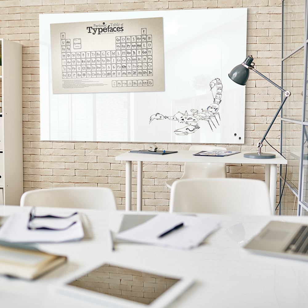 Desk with lamp and other business objects in office